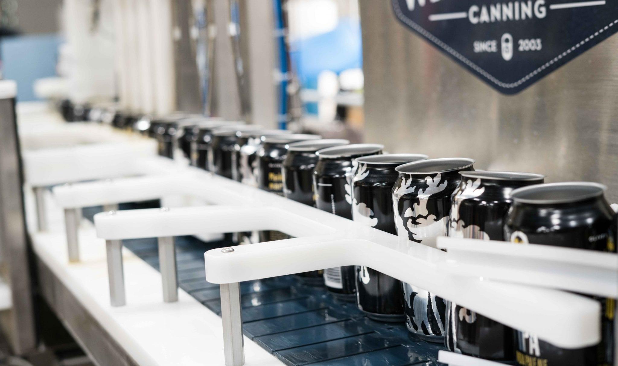 black cans evan-dvorkin-1480502-unsplash
